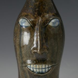 Matt Jones Pottery Bottle Face Jug